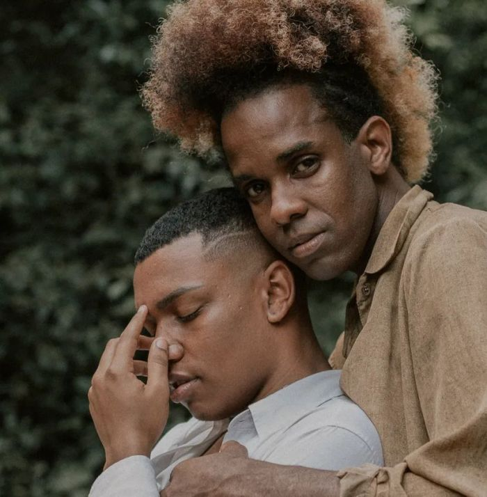 Two African American men embracing each other
