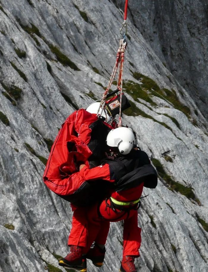 Two people in red going bungee jumping