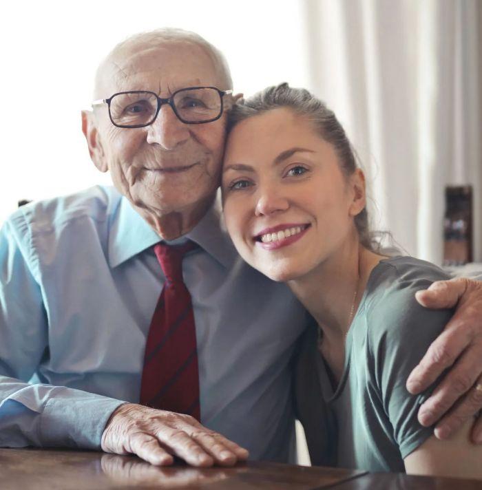 An elderly man a woman embracing each other