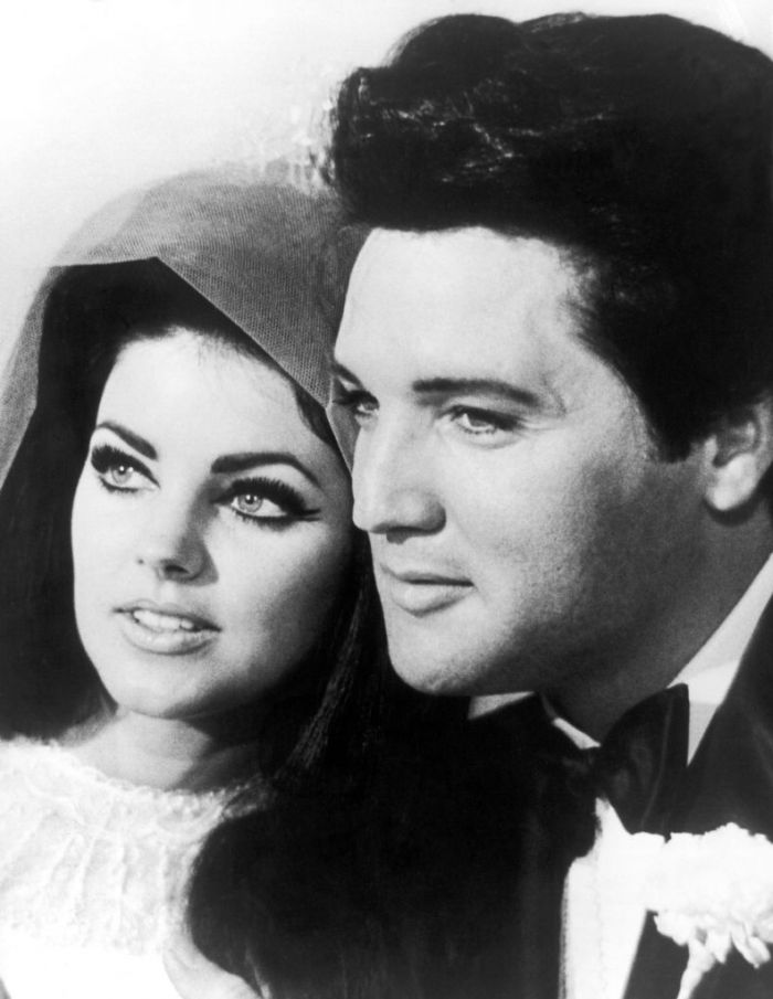 Elvis Presley with his wife Priscilla in black and white