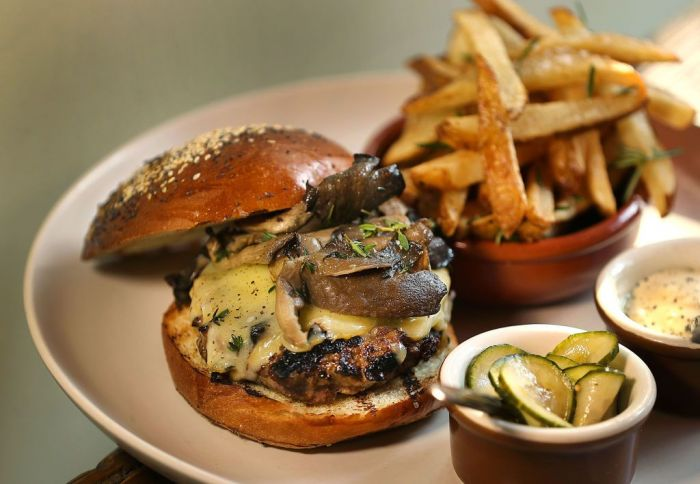 A mouthwatering cheeseburger with mushrooms and onions