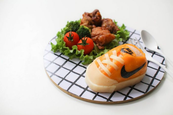 A nike running shoe made out of sushi