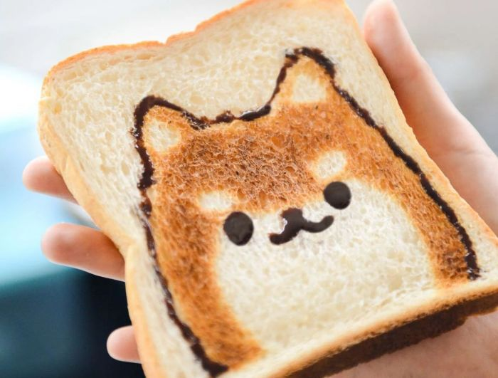 A piece of toast with a dog print on it