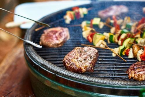 grilling steaks and vegetables on the bbq