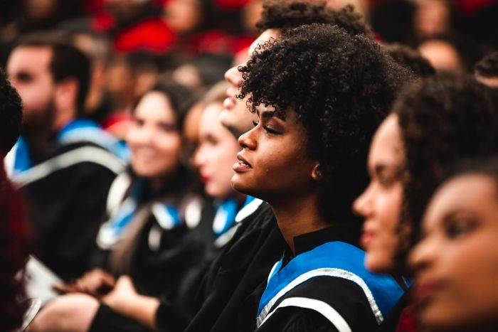 A girl at her graduation ceremony sitting in the crowd