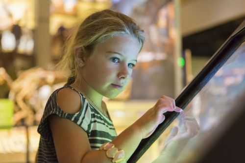 little girl at a museum