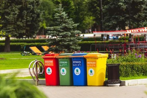 Four colored garbage cans arranged outside