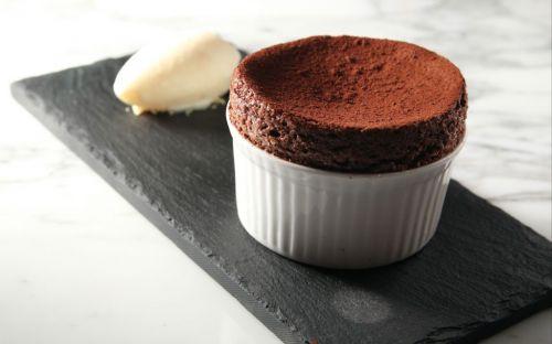 Chocolate Souffle in a white ramekin