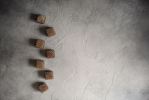 chocolate candies on wooden background