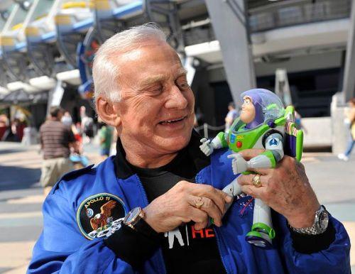 Buzz Aldrin holding Buzz Lightyear toy