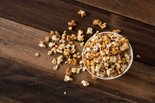 Caramel popcorn in a bowl on a wooden table