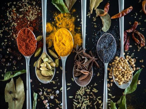Variety of spices on spoons
